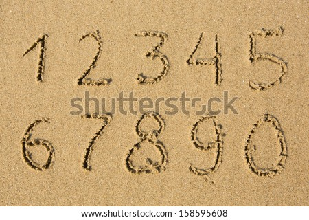 Numbers written on a sandy beach. (from 1 to 0) - stock photo