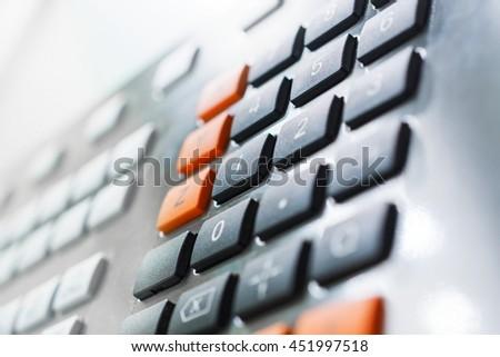 Numeric keypad CNC machine control panel. Shallow depth of field. - stock photo