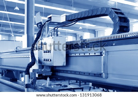 numerical control machine tool in a warehouse, in a manufacturing factory - stock photo