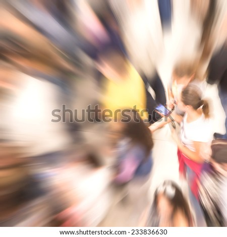 Numerous blurry people representing urban environment and everyday rush  - stock photo