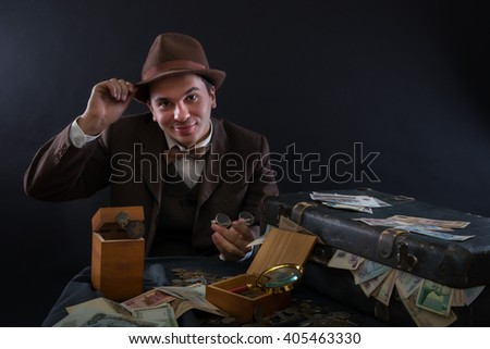 Numismatist with his coin collection