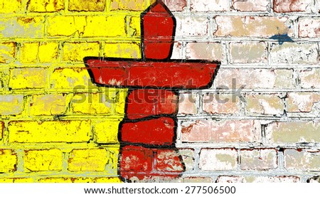 Nunavut flag painted on old brick wall texture background - stock photo