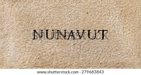 Nunavut province sign engraved in a rock plate