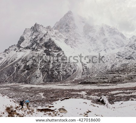 Nuptse peak in the cloudly weather - Everest region, Nepal, Himalayas - stock photo