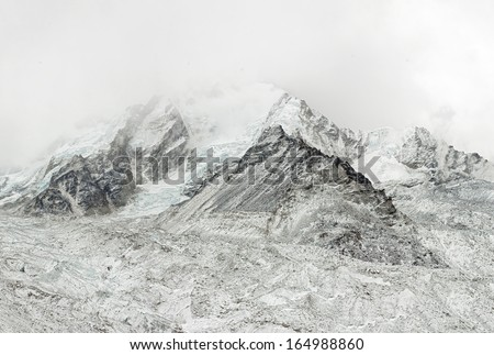 Nuptse wall to the cold weather - Everest region, Nepal, Himalayas - stock photo