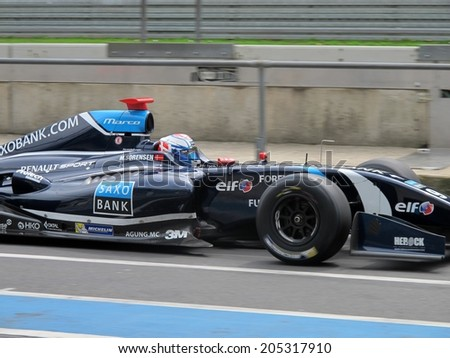 NURBURG, GERMANY - JULY 13, 2014:  Danish racing driver Marco Sorensen (Tech 1 Racing) driving through the pitlane during the World Series by Renault event on July 13, 2014 at Nurburg, Germany. - stock photo