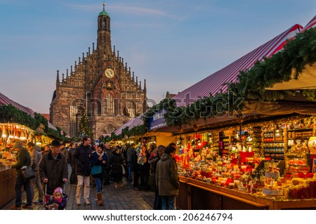 NUREMBERG, GERMANY - DECEMBER 2: People explore Christmas market on December 2 2013. Nuremberg's Christmas Market is one of Germany's oldest Christmas fairs dating back to the 16th century. - stock photo