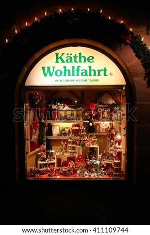 NUREMBERG, GERMANY - DECEMBER 21, 2013: Storefront with traditional German wooden souvenirs at night in Christmas, Kathe Wohlfahrt, Nuremberg, Germany
