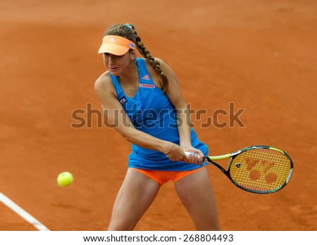 NUREMBERG, GERMANY - MAY 18: Swiss tennis player Belinda Bencic returns a ball during her Nurnberger Versicherungscup WTA tournament qualification match on May 18, 2014