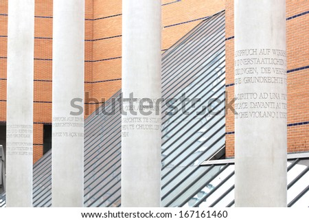 NUREMBERG, GERMANY - SEPTEMBER 21: Street of Human Rights with concrete pillars engraved with articles of the 1948 Universal Declaration of Human Rights on September 21, 2013 in Nuremberg, Germany. - stock photo