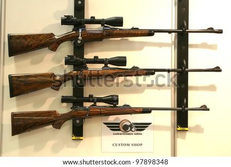 NURNBERG, GERMANY - MARCH 11: Christensen Arms rifles with Swarovski sights on display at IWA 2012 & OutdoorClassics exhibition on March 11, 2012 in Nurnberg, Germany - stock photo