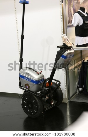 NURNBERG, GERMANY - MARCH 9: German police segway on display at IWA 2014 & Outdoor Classics exhibition on March 9, 2014 in Nurnberg, Germany - stock photo