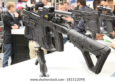 NURNBERG, GERMANY - MARCH 9: Kriss Vector SMG submachine gun on display at IWA 2014 & Outdoor Classics exhibition on March 9, 2014 in Nurnberg, Germany - stock photo