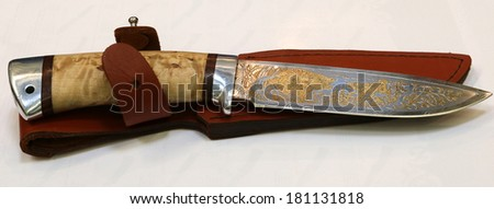 NURNBERG, GERMANY - MARCH 9: Russian handmade knife from Zlatoust on display at IWA 2014 & Outdoor Classics exhibition on March 9, 2014 in Nurnberg, Germany - stock photo