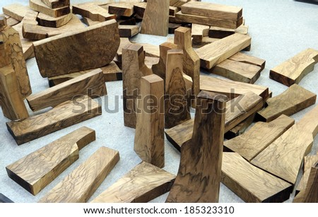 NURNBERG, GERMANY - MARCH 9: Wood parts prepared for making gun stocks on display at IWA 2014 & Outdoor Classics exhibition on March 9, 2014 in Nurnberg, Germany - stock photo
