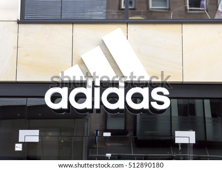 NURNBERG,GERMANY- November 1, 2016: Adidas logo on a wall. Adidas is a German multinational that manufactures sports shoes, clothing. It is the second biggest sportswear manufacturer in the world
