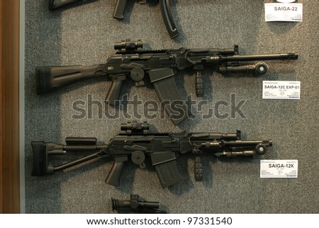 NURNBERG - MARCH 11: Izhmash Saiga-12 family of self-loading rifles on display at IWA 2012 & OutdoorClassics exhibition on March 11, 2012 in Nurnberg, Germany - stock photo