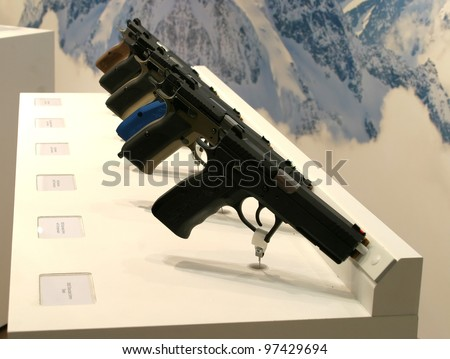NURNBERG - MARCH 11: Sphinx pistols on display at IWA 2012 & OutdoorClassics exhibition on March 11, 2012 in Nurnberg, Germany - stock photo