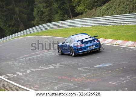 NURNBURGRING, GERMANY - SEPTEMBER 26: A sportscar is driving the legendary Nurnburgring race track in Germany on September 26th, 2015 in Germany. Image is taken in a small angle to emphasize speed.