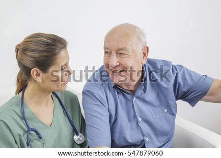 Nurse and senior man during an medical exam