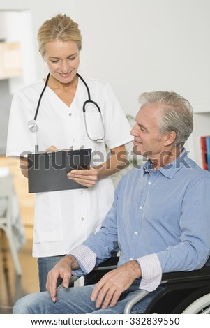 Nurse at home with handicapped man