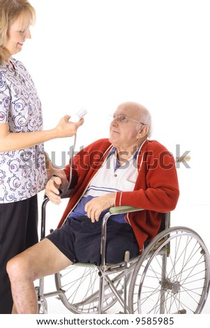 nurse checking handicap mans stats - stock photo