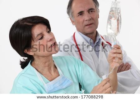 Nurse checking perfusion - stock photo