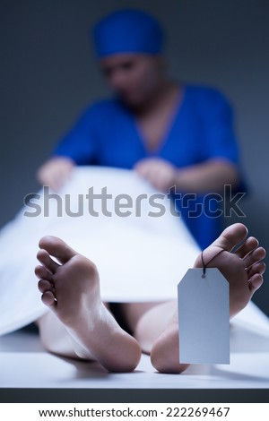 Nurse during working in the mortuary, vertical