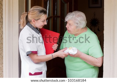 nurse greeted with her ??patient - stock photo