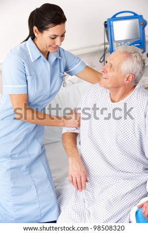 Nurse helping male patient in UK Accident and Emergency - stock photo