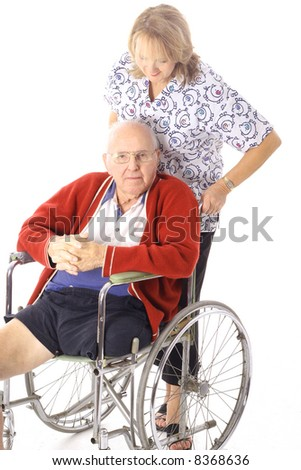 nurse helping patient after amputation - stock photo