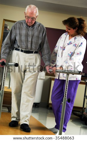 nurse helping senior man with physical rehabilitation