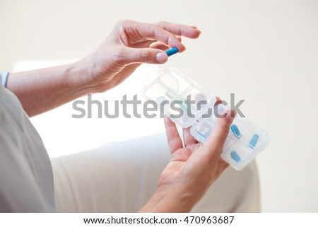 Nurse holding box with medicals