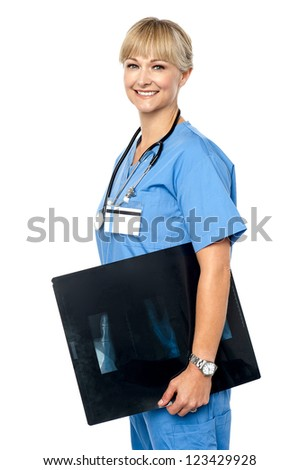 Nurse holding x-ray sheet to be passed up to a senior doctor. Isolated against white background. - stock photo