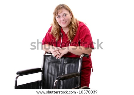 Nurse leaning on a patients wheelchair. - stock photo