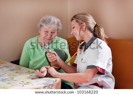 nurse measures the blood pressure of a patient