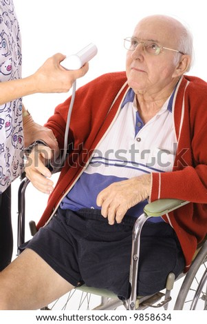 nurse monitoring blood pressure - stock photo