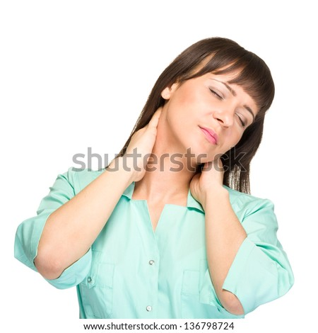 Nurse or young woman doctor having neck pain, isolated on white background. - stock photo