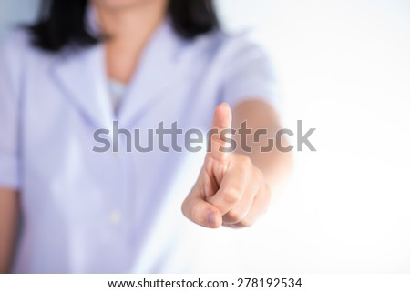 Nurse pressing type with finger of hand show business and health care background