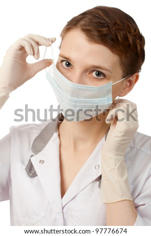 Nurse putting on medical mask
