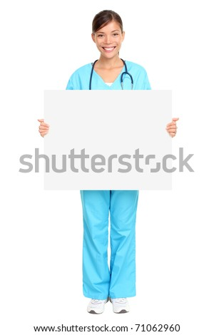 Nurse showing medical sign billboard standing in full length. Young smiling woman nurse or doctor in scrubs showing empty blank sign board with copy space. Asian model isolated on white background. - stock photo