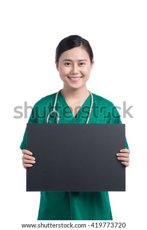 Nurse showing medical sign billboard standing, Young smiling woman nurse or doctor in uniform showing empty blank sign board with copy space. Asian model isolated on white background - stock photo