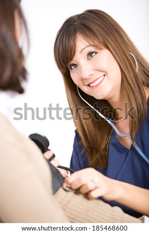 Nurse: Taking The Blood Pressure Of A Patient - stock photo