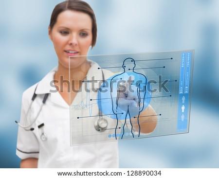 Nurse using a futuristic interface - stock photo