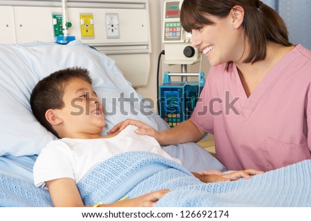 Nurse Visiting Child Patient On Ward