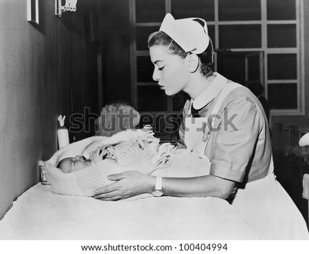 Nurse with crying baby - stock photo
