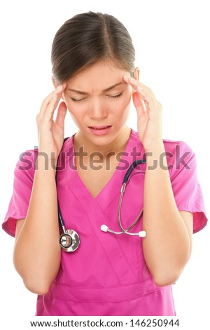 Nurse with headache stress. Nurse / doctor with migraine headache overworked and stressed. Health care professional in pink scrubs wearing stethoscope isolated on white background. - stock photo