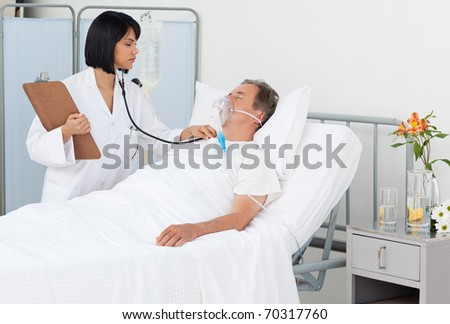 Nurse with her mature patient in a hospital - stock photo