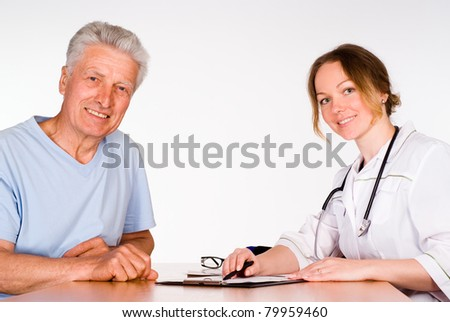 nurse with patient at table on a white