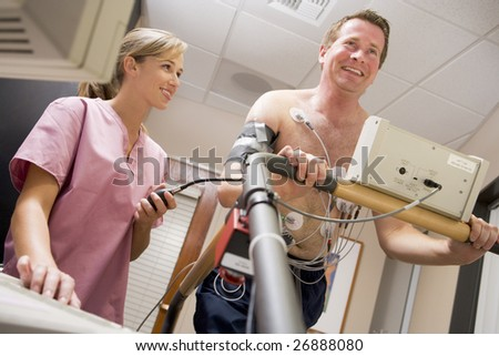 Nurse With Patient During Health Check - stock photo